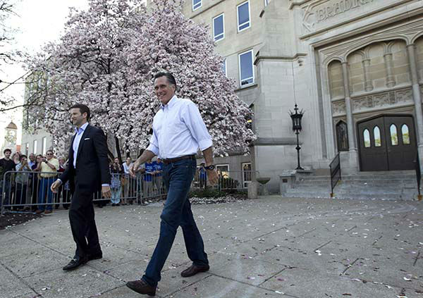 <div class='meta'><div class='origin-logo' data-origin='none'></div><span class='caption-text' data-credit='AP Photo/ Steven Senne'>Mitt Romney, right, and Rep. Aaron Schock, R-Ill., left, arrive at a Romney campaign rally at Bradley University, in Peoria, Ill., Monday, March 19, 2012.</span></div>