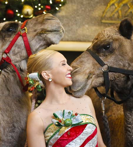 <div class='meta'><div class='origin-logo' data-origin='none'></div><span class='caption-text' data-credit='AP Photo/Bebeto Matthews'>Radio City Rockette star Lauren Renck stands between camels during the blessing of animals at Radio City Music Hall in New York.</span></div>
