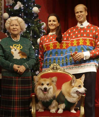 <div class='meta'><div class='origin-logo' data-origin='none'></div><span class='caption-text' data-credit='AP Photo/Alastair Grant'>Two Welsh Pembrokeshire Corgi dogs sit on a chair in front of wax work models of the British Royal family at Madame Tussauds wax works in London.</span></div>