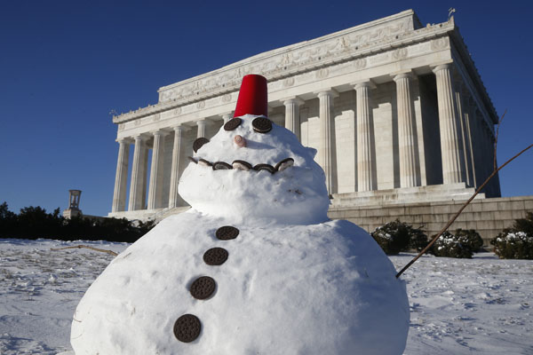 "<div class=""meta image-caption""><div class=""origin-logo origin-image none""><span>none</span></div><span class=""caption-text"">A snowman made with cookies and a red plastic cup sits in front of the Lincoln Memorial in Washington, Wednesday, Jan. 22, 2014. ((AP Photo/Charles Dharapak))</span></div>"