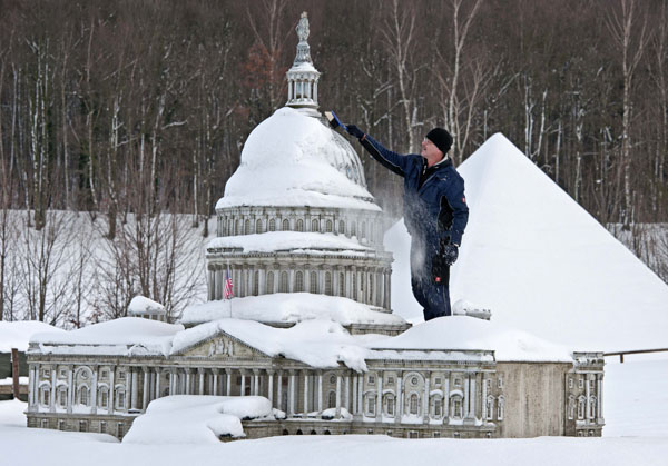 "<div class=""meta image-caption""><div class=""origin-logo origin-image none""><span>none</span></div><span class=""caption-text"">Gunter Hersch cleans a model of the Capitol of Washington model after heavy snowfall in the landscape park Miniwelt (Miniworld) in Lichtenstein, Germany, Friday, Dec. 7, 2012. ((AP Photo/Jens Meyer))</span></div>"