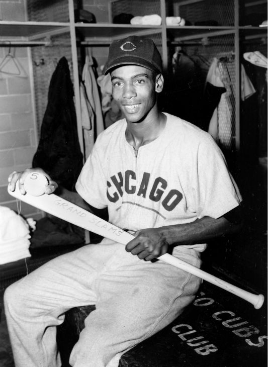 <div class='meta'><div class='origin-logo' data-origin='none'></div><span class='caption-text' data-credit='AP Photo/ XNBG'>Ernie Banks of the Chicago Cubs holds his grand slam bat and ball after setting a new record with his fifth bases-loaded homer in St. Louis, Mo., Sept. 19, 1955.  (AP Photo)</span></div>