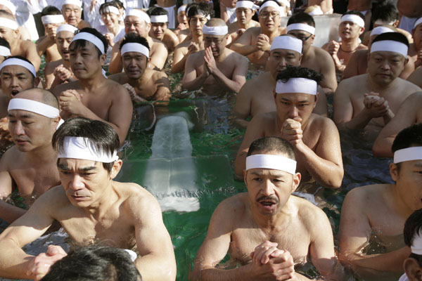 <div class='meta'><div class='origin-logo' data-origin='AP'></div><span class='caption-text' data-credit='(AP Photo/Shizuo Kambayashi)'>Japanese physical fitness enthusiasts pray while dipping in cold water during a winter ritual to keep themselves fit and to display their perseverance in Tokyo.</span></div>