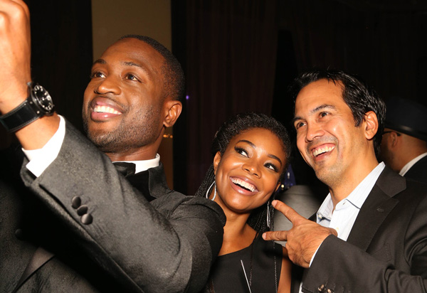 "<div class=""meta image-caption""><div class=""origin-logo origin-image ap""><span>AP</span></div><span class=""caption-text"">Dwyane Wade, Gabrielle Union and Erik Spoelstra, Coach of the Miami Heat, pose for a photo during the RunWade Fashion Show on Saturday, Nov. 14, 2015 in Miami, Fla. (Omar Vega/Invision/AP)</span></div>"