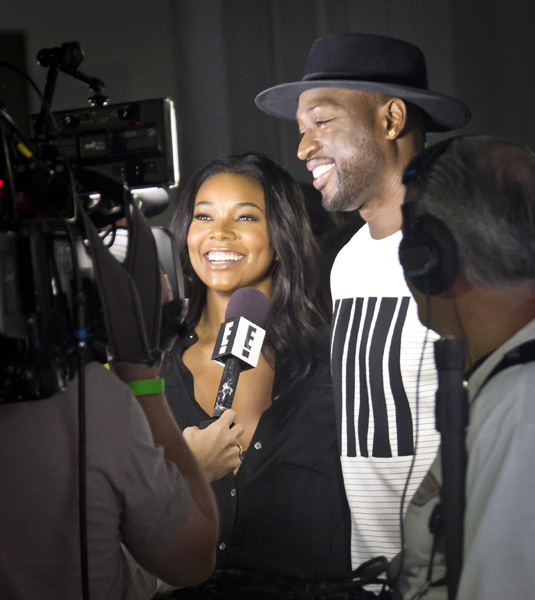 "<div class=""meta image-caption""><div class=""origin-logo origin-image ap""><span>AP</span></div><span class=""caption-text"">Actress Gabrielle Union, left, and Miami Heat basketball player Dwayne Wade are interviewed during the presentation of the Public School collection on Tuesday, July 14, 2015. (AP Photo/Bebeto Matthews)</span></div>"