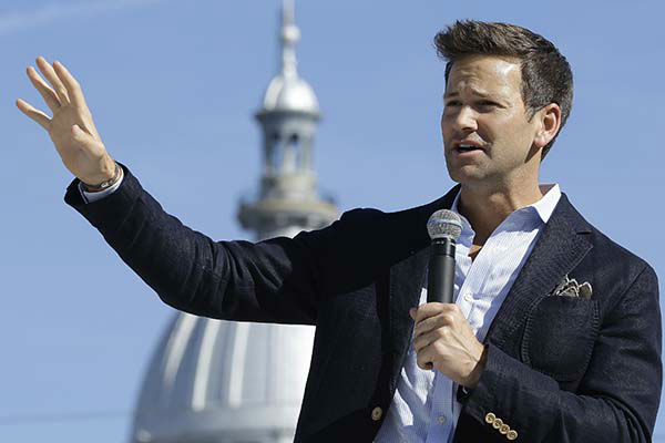 <div class='meta'><div class='origin-logo' data-origin='none'></div><span class='caption-text' data-credit='AP Photo/ Seth Perlman'>U.S. Rep. Aaron Schock, R-Ill., speaks during a campaign rally outside the State Capitol in Springfield, Ill., Monday, Nov. 3, 2014.</span></div>