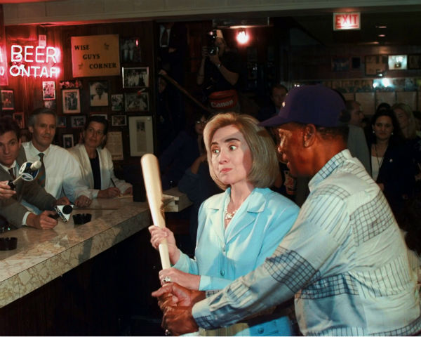 <div class='meta'><div class='origin-logo' data-origin='none'></div><span class='caption-text' data-credit='AP Photo/ RUTH FREMSON'>Hillary Rodham Clinton poses for photographers with Chicago Cubs legend Ernie Banks during a visit to Chicago's famed Billy Goat Tavern on Aug. 28, 1996. (AP Photo/Ruth Fremson)</span></div>