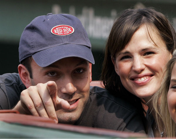 <div class='meta'><div class='origin-logo' data-origin='none'></div><span class='caption-text' data-credit=''>Actor Ben Affleck points while Jennifer Garner smiles as they sit next to the Boston Red Sox dugout  at Fenway Park in Boston Saturday, June 2, 2007. (AP Photo/Elise Amendola)</span></div>