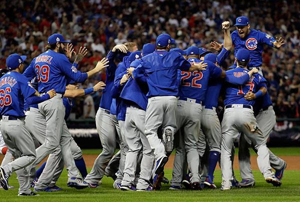 <div class='meta'><div class='origin-logo' data-origin='none'></div><span class='caption-text' data-credit='AP Photo/David J. Phillip'>The Chicago Cubs celebrate after Game 7 of the Major League Baseball World Series.</span></div>