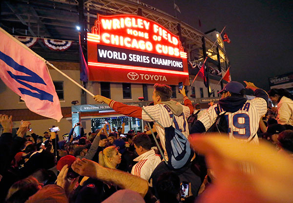 <div class='meta'><div class='origin-logo' data-origin='none'></div><span class='caption-text' data-credit='AP Photo/Charles Rex Arbogast'>Chicago Cubs fans celebrate after Game 7 of the Major League Baseball World Series. The Cubs won 8-7 in 10 innings to win the series 4-3.</span></div>