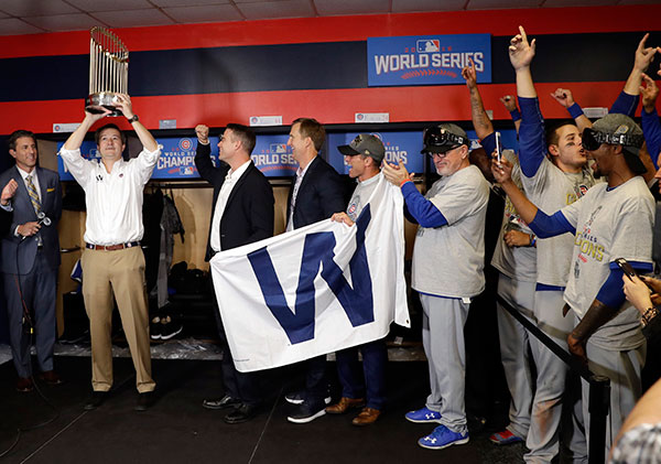 <div class='meta'><div class='origin-logo' data-origin='none'></div><span class='caption-text' data-credit='AP Photo/David J. Phillip'>Chicago Cubs Chairman Tom Ricketts holds up the trophy as he celebrates with the team after Game 7.</span></div>