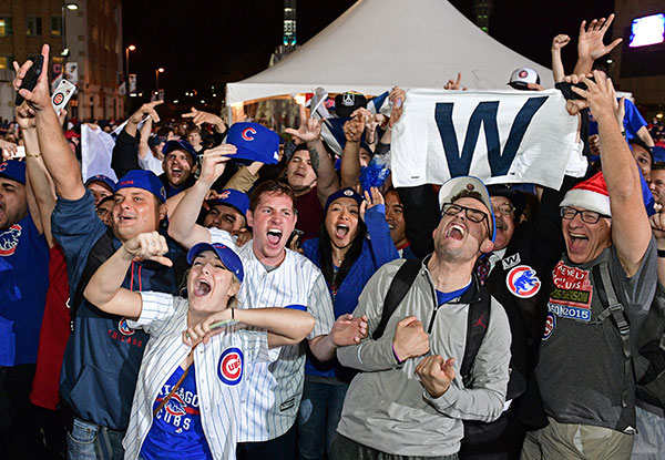 <div class='meta'><div class='origin-logo' data-origin='none'></div><span class='caption-text' data-credit='AP Photo/David Dermer'>Chicago Cubs fans celebrate after Game 7 of the Major League Baseball World Series. The Cubs won 8-7 in 10 innings to win the series 4-3.</span></div>