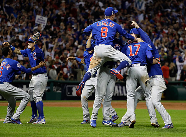 <div class='meta'><div class='origin-logo' data-origin='none'></div><span class='caption-text' data-credit='AP Photo/David J. Phillip'>The Chicago Cubs celebrate after Game 7 of the Major League Baseball World Series against the Cleveland Indians.</span></div>