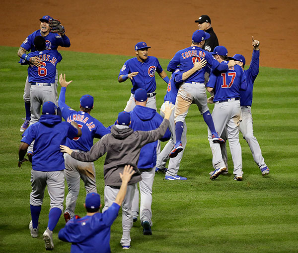 <div class='meta'><div class='origin-logo' data-origin='none'></div><span class='caption-text' data-credit='AP Photo/Gene J. Puskar'>The Chicago Cubs celebrate after Game 7 of the Major League Baseball World Series. The Cubs won 8-7 in 10 innings to win the series 4-3.</span></div>