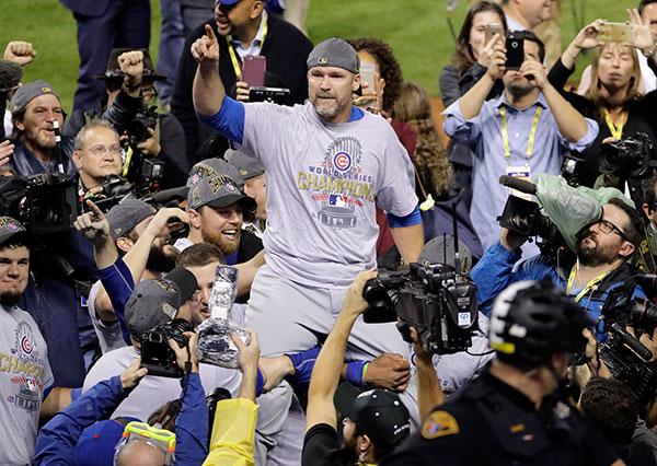 <div class='meta'><div class='origin-logo' data-origin='none'></div><span class='caption-text' data-credit='AP Photo/Gene J. Puskar'>Chicago Cubs' David Ross is carried by teammates after Game 7 of the Major League Baseball World Series. The Cubs won 8-7 in 10 innings to win the series 4-3.</span></div>
