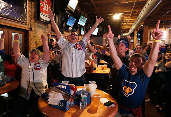 <div class='meta'><div class='origin-logo' data-origin='none'></div><span class='caption-text' data-credit='AP Photo/Charles Rex Arbogast'>Chicago Cubs fans celebrate at the Cubby Bear bar across the street from Wrigley Field after Dexter Fowler's first-inning home run during Game 7.</span></div>