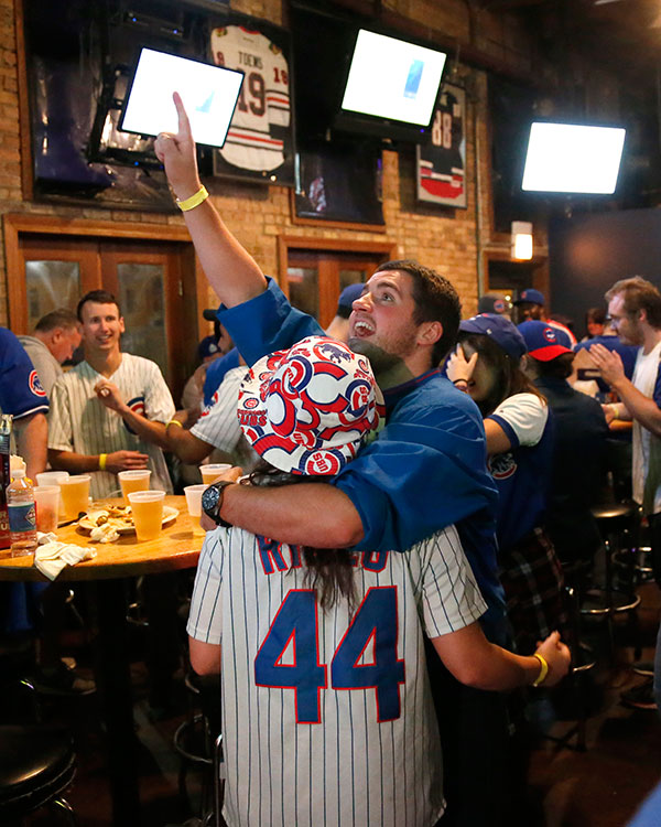 <div class='meta'><div class='origin-logo' data-origin='none'></div><span class='caption-text' data-credit='AP Photo/Charles Rex Arbogast'>Chicago Cubs fans celebrate at the Cubby Bear bar across the street from Wrigley Field after Javier Baez's fifth-inning home run against the Cleveland Indians during Game 7.</span></div>
