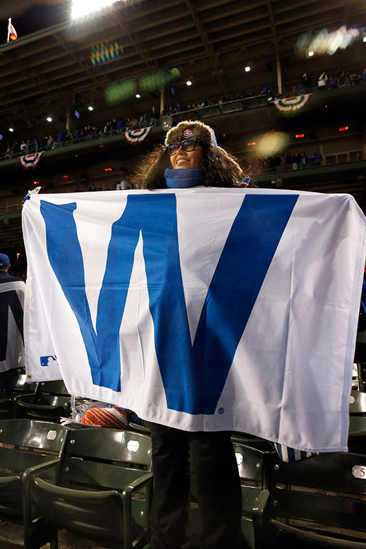 <div class='meta'><div class='origin-logo' data-origin='none'></div><span class='caption-text' data-credit='AP Photo/Nam Y. Huh'>A Chicago Cubs fan celebrates after Game 5.</span></div>