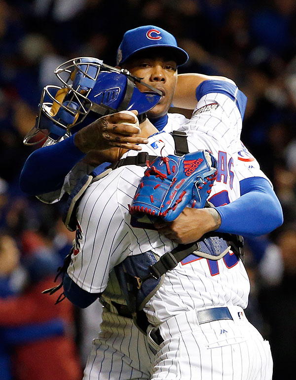 <div class='meta'><div class='origin-logo' data-origin='none'></div><span class='caption-text' data-credit='AP Photo/Nam Y. Huh'>Chicago Cubs relief pitcher Aroldis Chapman and catcher Willson Contreras celebrate after Game 5.</span></div>