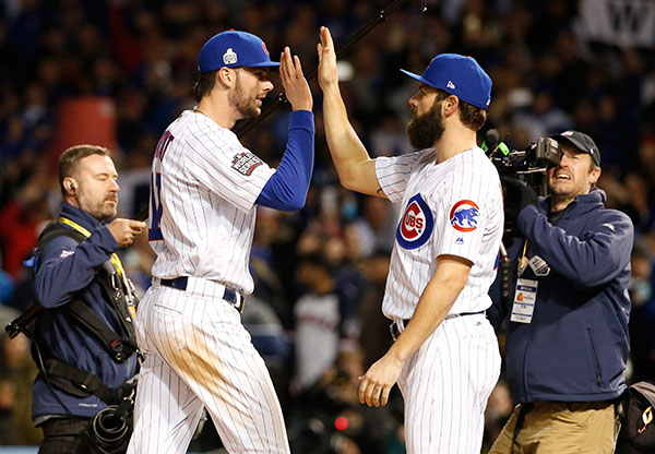 <div class='meta'><div class='origin-logo' data-origin='none'></div><span class='caption-text' data-credit='AP Photo/Nam Y. Huh'>Chicago Cubs' Kris Bryant, left, celebrates with Jake Arrieta after Game 5.</span></div>
