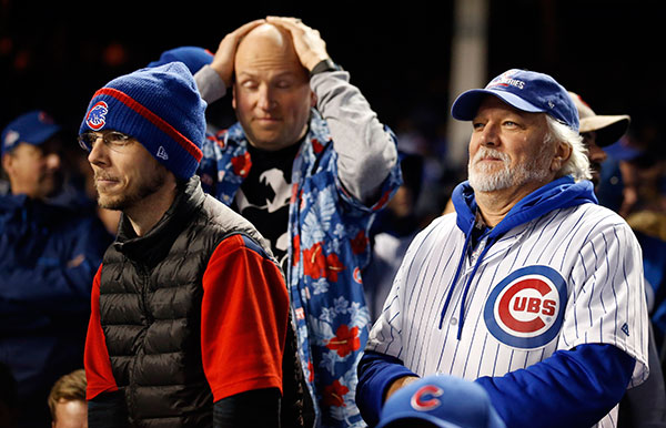 <div class='meta'><div class='origin-logo' data-origin='none'></div><span class='caption-text' data-credit='AP Photo/Nam Y. Huh'>Chicago Cubs fans reacts during the eighth inning of Game 5.</span></div>