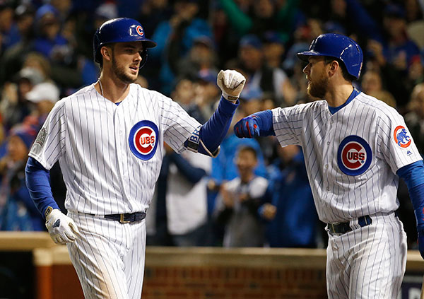 <div class='meta'><div class='origin-logo' data-origin='none'></div><span class='caption-text' data-credit='AP Photo/Nam Y. Huh'>Chicago Cubs' Kris Bryant, left, celebrates with Ben Zobrist after hitting a home run during the fourth inning of Game 5.</span></div>