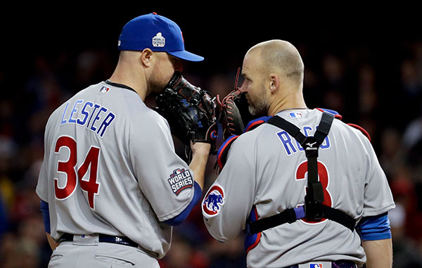 <div class='meta'><div class='origin-logo' data-origin='none'></div><span class='caption-text' data-credit='AP Photo/Matt Slocum'>Chicago Cubs starting pitcher Jon Lester, left, and catcher David Ross talk during the sixth inning of Game 1.</span></div>