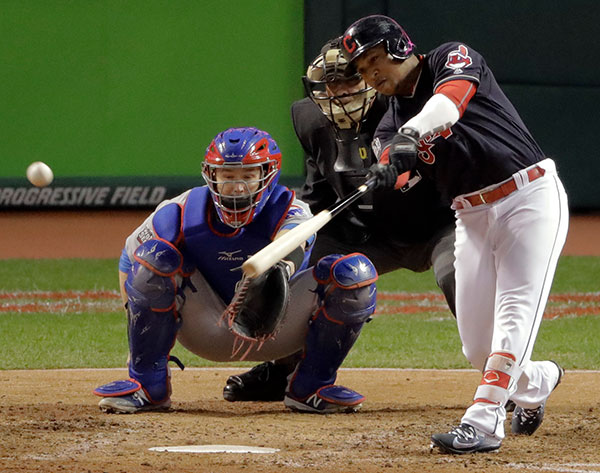 <div class='meta'><div class='origin-logo' data-origin='none'></div><span class='caption-text' data-credit='AP Photo/Charlie Riedel'>Cleveland Indians' Jose Ramirez hits a RBI single against the Chicago Cubs during the first inning.</span></div>