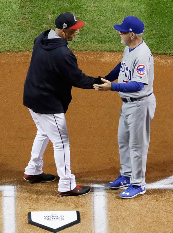 "<div class=""meta image-caption""><div class=""origin-logo origin-image none""><span>none</span></div><span class=""caption-text"">Cleveland Indians manager Terry Francona sakes hands with Chicago Cubs manager Joe Maddon before Game 1. (AP Photo/Matt Slocum)</span></div>"