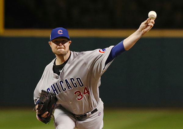 <div class='meta'><div class='origin-logo' data-origin='none'></div><span class='caption-text' data-credit='AP Photo/Elsa Garrison'>Chicago Cubs starting pitcher Jon Lester throws during the first inning of Game 1.</span></div>