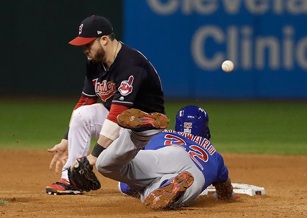 <div class='meta'><div class='origin-logo' data-origin='none'></div><span class='caption-text' data-credit='AP Photo/David J. Phillip'>Cleveland Indians' Jason Kipnis can't handle the throw as Chicago Cubs' Jason Heyward steals second and advances to third on the throw during the ninth inning of Game 7.</span></div>