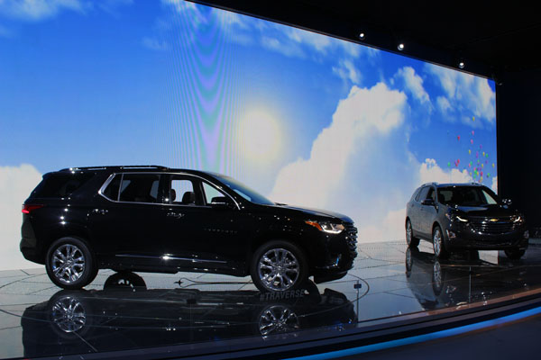 "<div class=""meta image-caption""><div class=""origin-logo origin-image wls""><span>WLS</span></div><span class=""caption-text"">The 2018 Chevy Traverse (left) and 2018 Chevy Equinox on display at the 2017 Chicago Auto Show on Feb. 9, 2017.</span></div>"
