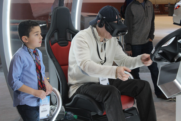 <div class='meta'><div class='origin-logo' data-origin='WLS'></div><span class='caption-text' data-credit=''>Attendees test out a virtual reality headset at the Acura exhibit at the 2017 Chicago Auto Show on Feb. 10, 2017.</span></div>