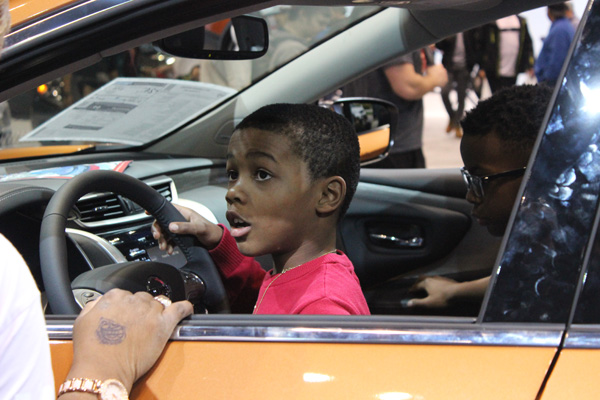 <div class='meta'><div class='origin-logo' data-origin='WLS'></div><span class='caption-text' data-credit=''>A young boy behind the wheel of the 2017 Nissan Rogue Sport at the 2017 Chicago Auto Show at McCormick Place on Feb. 11, 2017.</span></div>