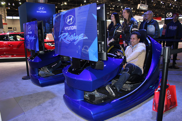 <div class='meta'><div class='origin-logo' data-origin='WLS'></div><span class='caption-text' data-credit=''>Visitors try the Hyundai Racing Challenge racetrack simulation at the 2017 Chicago Auto Show on February 13, 2017.</span></div>