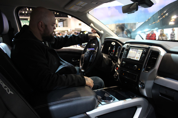 <div class='meta'><div class='origin-logo' data-origin='WLS'></div><span class='caption-text' data-credit=''>A visitor behind the wheel of a 2017 Nissan Titan Pro-4X at the 2017 Chicago Auto Show on February 13, 2017.</span></div>
