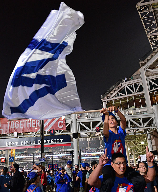 <div class='meta'><div class='origin-logo' data-origin='none'></div><span class='caption-text' data-credit='AP Photo/David Dermer'>Chicago Cubs fans Ricky Urbina Jr. and Ricky Urbina Sr. Celebrate during a watch party after Game 7.</span></div>