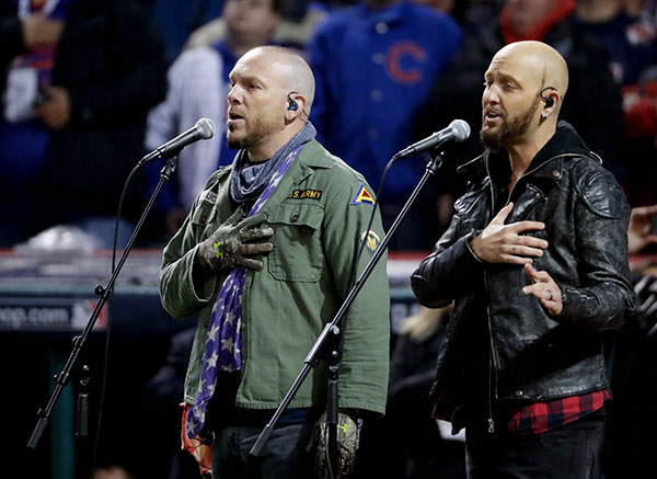 <div class='meta'><div class='origin-logo' data-origin='none'></div><span class='caption-text' data-credit='AP Photo/Matt Slocum'>Country music duo, LoCash sings the national anthem before Game 2.</span></div>