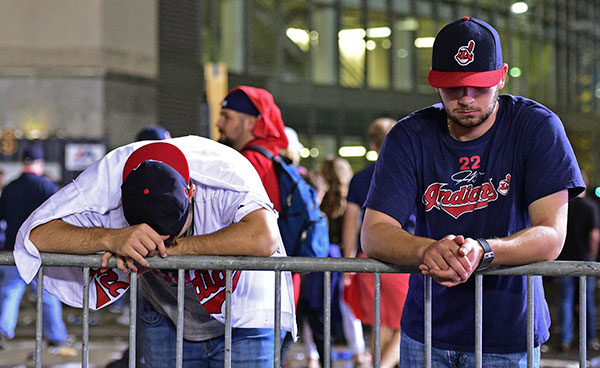 <div class='meta'><div class='origin-logo' data-origin='none'></div><span class='caption-text' data-credit='AP Photo/David Dermer'>Cleveland Indians fans Levi Jones, left, and Kyle Zabarsky react during a watch party, after Game 7.</span></div>
