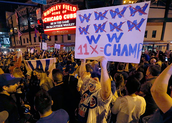 <div class='meta'><div class='origin-logo' data-origin='none'></div><span class='caption-text' data-credit='AP Photo/Charles Rex Arbogast'>Chicago Cubs fans celebrate outside Wrigley Field in Chicago after the Cubs' 9-3 win over the Cleveland Indians in Game 6.</span></div>