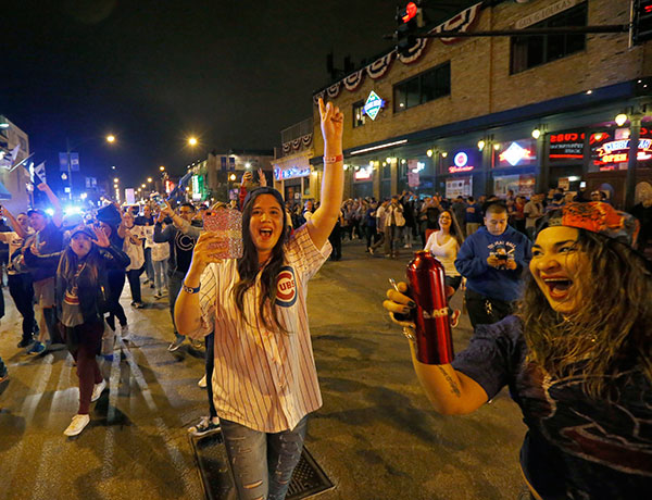 <div class='meta'><div class='origin-logo' data-origin='none'></div><span class='caption-text' data-credit='AP Photo/Charles Rex Arbogast'>Chicago Cubs fans celebrate outside Wrigley Field in Chicago after the Cubs' 9-3 win over the Cleveland Indians in Cleveland in Game 6.</span></div>