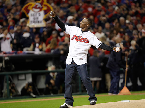 <div class='meta'><div class='origin-logo' data-origin='none'></div><span class='caption-text' data-credit='AP Photo/David J. Phillip'>Former Cleveland Indians outfielder Kenny Lofton throws the ceremonial first pitch before Gam</span></div>