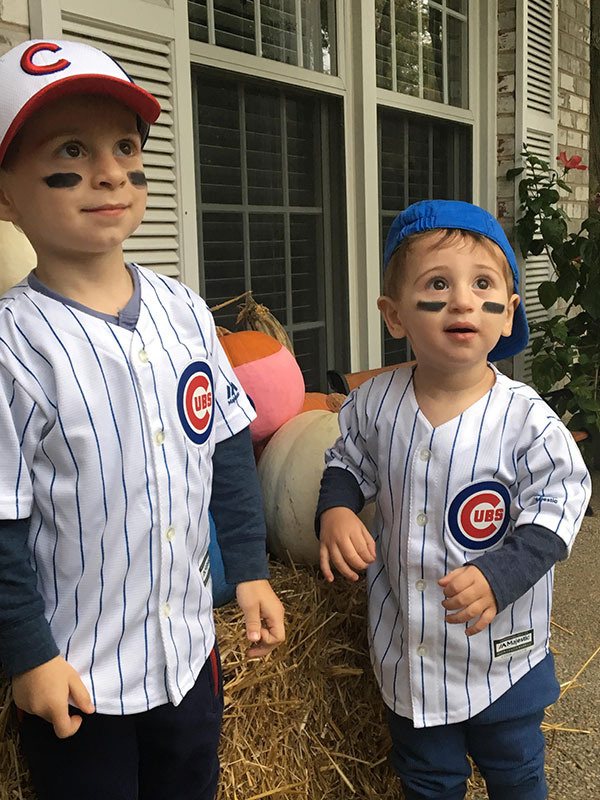<div class='meta'><div class='origin-logo' data-origin='none'></div><span class='caption-text' data-credit=''>Two young Chicago Cubs fans.</span></div>