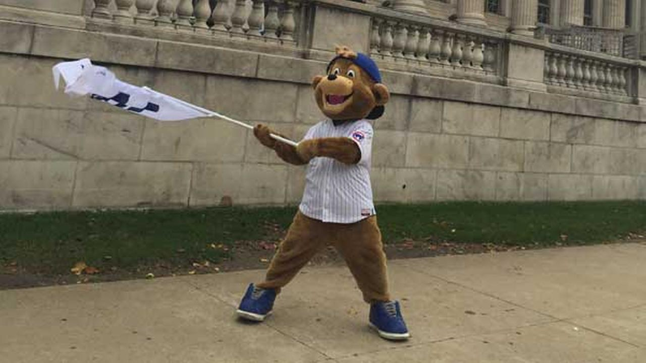 Chicago Cubs mascot Clark the Cub surprised fans with free gear leading up to the NL wild-card game. He wants to see you #FlytheW!