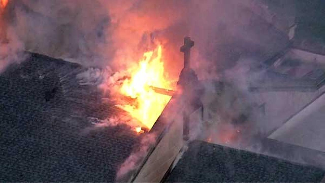 Firefighters battled an extra-alarm fire at Shrine of Christ the King Church in Chicagos Woodlawn neighborhood.