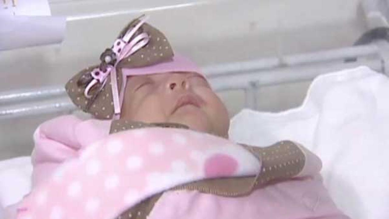A baby girl who weighed less than a pound when she was born is now at home with her parents in Brazil.
