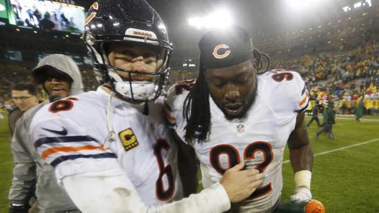 Chicago Bears Jay Cutler (6) and Pernell McPhee (92) celebrate after an NFL football game against the Green Bay Packers in Green Bay, Wis. The Bears won 17-13.