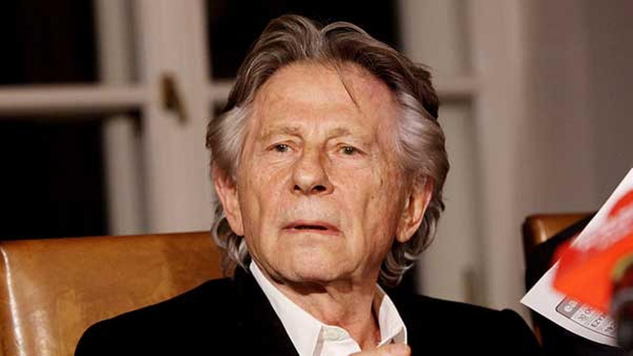 In this Oct. 30, 2015 file photo filmmaker Roman Polanski tells reporters he can breath with relief after a Polish judge ruled that the law forbids his extradition to the U.S.