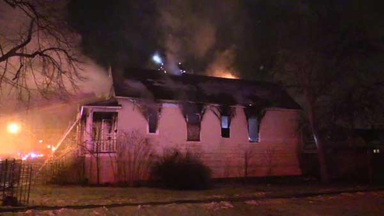 Four people were forced out of their homes after fire spread from an empty building to an apartment building in the citys South Chicago neighborhood.