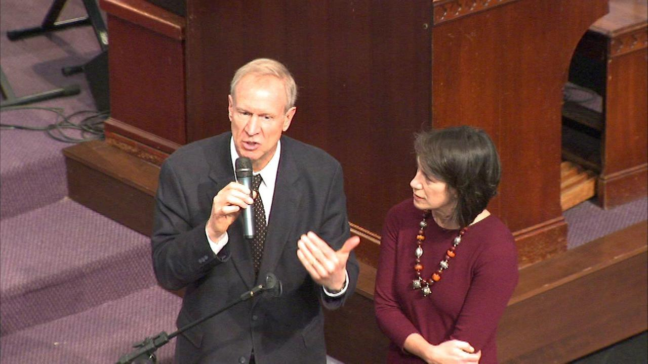 Gov. Bruce Rauner and his wife at New Covenant Missionary Baptist Church on Sunday, Jan. 17.